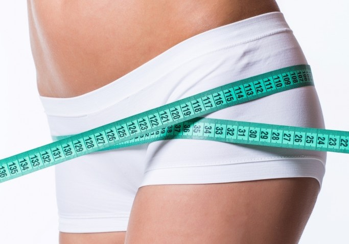 young-woman-measuring-perfect-shape-beautiful-thigh-healthy-lifestyles-concept